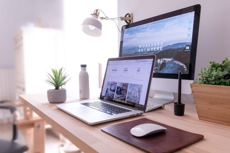 monitor, mouse, and laptop in eco-friendly workplace